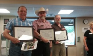 From right to left: Ron Eber, Jerry Darnall & Scott Hall - Accepting awards for their support of local agriculture and the new Ag. Code